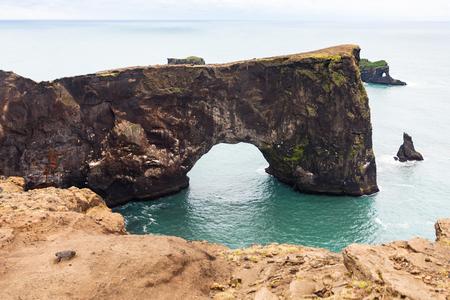 travel to Iceland - lava arch on Dyrholaey peninsula, near Vik I Myrdal village on Atlantic South Coast in Katla Geopark in september Stok Fotoğraf - 90598113