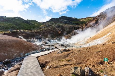 travel to Iceland - wooden pathway in geothermal Krysuvik area on Southern Peninsula (Reykjanesskagi, Reykjanes Peninsula) in september Stock Photo