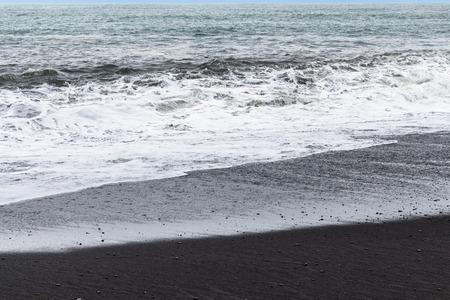 travel to Iceland - ocean surf on Reynisfjara black beach in Iceland, near Vik I Myrdal village on Atlantic South Coast in Katla Geopark in september Stok Fotoğraf - 90598196