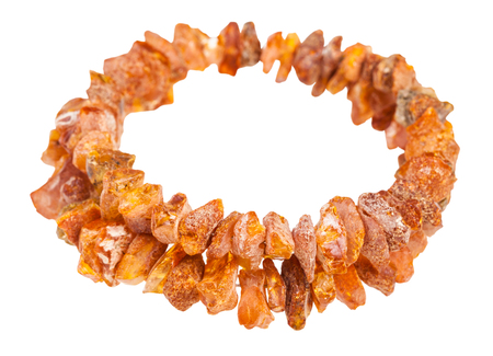bracelet from two strings of rough amber stones isolated on white background
