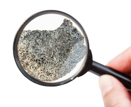 view of rough peridotite mineral through magnifier isolated on white background