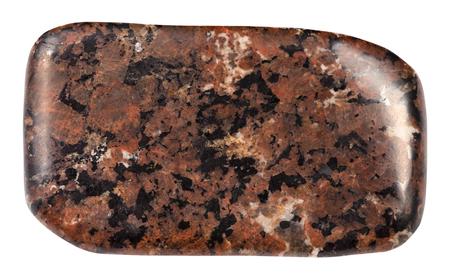 macro shooting of natural mineral rock specimen - tumbled spreusteined urtite stone isolated on white background from Khibiny Mountains, Kola Peninsula, Russia Stock Photo