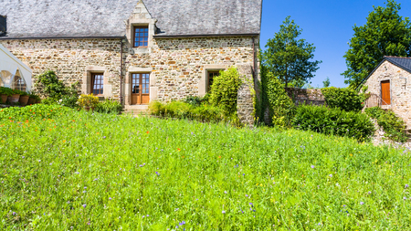 PLOEZAL, FRANCE - JULY 3, 2010: green lawn on courtyard of medieval castle Chateau de la Roche-Jagu in Cotes-dArmor department of Brittany in sunny summer day. The castle was built in 1418.