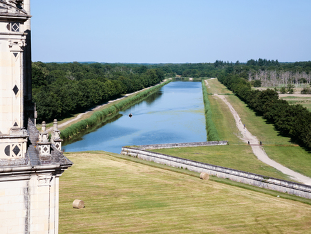 CHAMBORD, FRANCE - JULY 7, 2010: view of Cosson river and garden of castle Chateau de Chambord. Chambord is the largest chateau in the Loire Valley, it was built as a hunting palace in 1519-1547