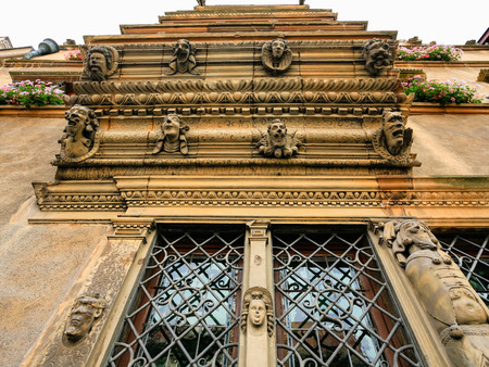 COLMAR, FRANCE - JULY 11, 2010: decorated window of Maison des Tetes (House of Heads) on Rue des Tetes in Colmar.This house was built in 1609 by architect Hans Burge