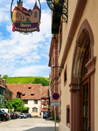 RIQUEWIHR, FRANCE - JULY 11, 2010: cityscape with vineyard of Riquewihr town. Riquewihr is commune in Alsace Wine Route region, the town belongs to Association The most beautiful villages of France