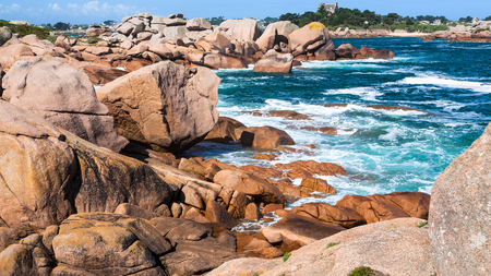 travel to France - rocky shore of English Channel in Ploumanach site of Perros-Guirec commune on Pink Granite Coast of Cotes-dArmor department in the north of Brittany in sunny summer day