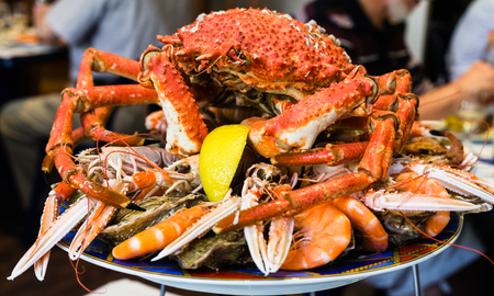 travel to France - atlantic crab on seafood plate in local fish restaurant in Treguier town in the Cotes-d'Armor department of Brittany Stock Photo - 94188201