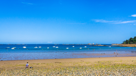 travel to France - panoramic view of beach Plage de la Baie de Launay on bay Anse de Launay of English Channel in Paimpol region of Cotes-dArmor department of Brittany in sunny summer day