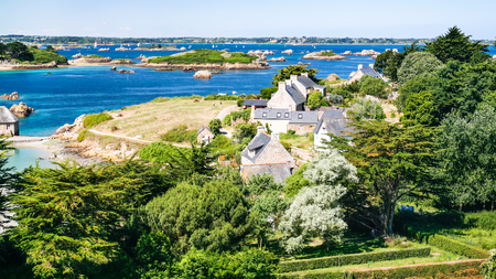 travel to France - above view of country houses on ocean coast in Brehat commune at Ile-de-Brehat island in Cotes-dArmor department of Brittany in summer sunny day Stock Photo