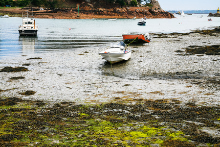 travel to France - boats in Port-Clos harbour of Ile-de-Brehat island in Cotes-dArmor department of Brittany in during low tide in summer Stock Photo