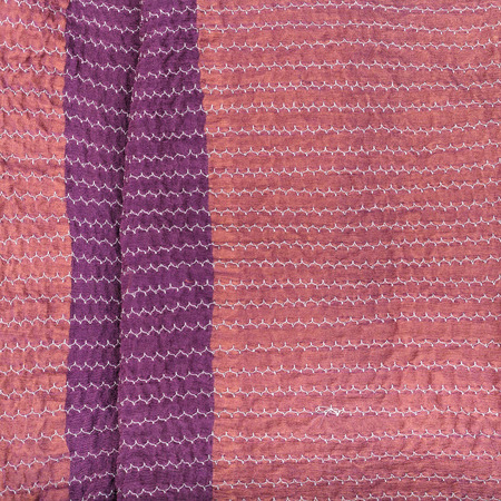 workshop on sewing a patchwork scarf - pink textile background from stitched strips of silk fabrics