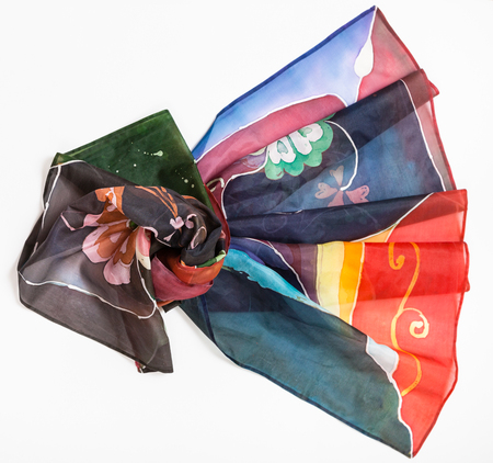 hand painted batik silk headscarf with abstract floral pattern on white background