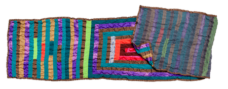 stitched double patchwork scarf from silk strips isolated on white background