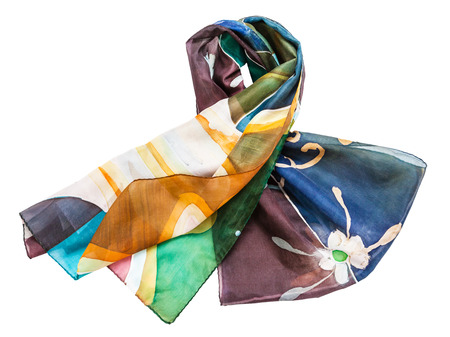 knotted hand painted batik silk scarf with abstract floral pattern isolated on white background Stock Photo