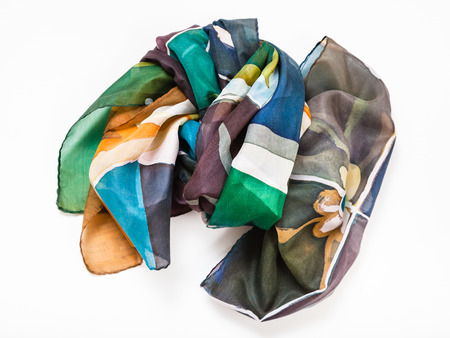 wrapped hand painted batik silk scarf with abstract floral pattern on white background