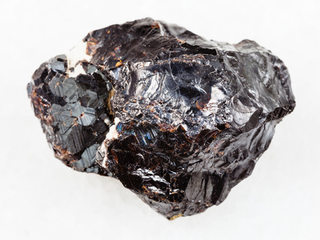 macro shooting of natural mineral rock specimen - raw Sphalerite stone on white marble background from Dalnegorsk region of Primorsky Krai, Russia