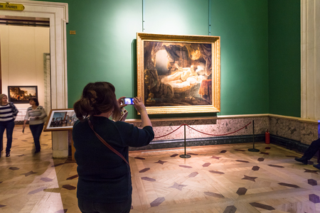 SAINT PETERSBURG, RUSSIA - MARCH 16, 2018: visitors in Rembrandt room in Hermitage museum. The State Hermitage is second largest museum of art and culture in the world, it was founded in 1764 報道画像