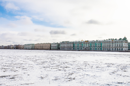 view of frozen Neva river and Dvortsovaya embankment in Saint Petersburg city in March