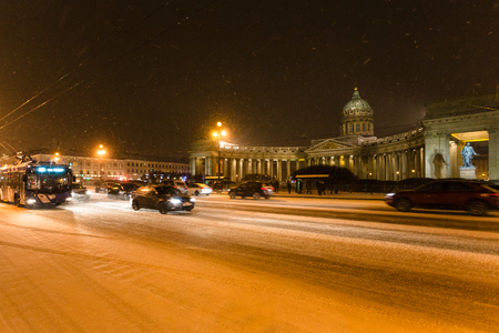 view of snow-covered Nevsky Prospect with Kazan Cathedral in night snowfall in Saint Petersburg city in March