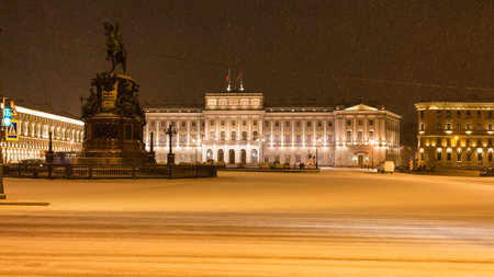 night panoramic view of St Isaacs Square with Monument to Nicholas I and Mariinsky Palace in St Petersburg in snowfall