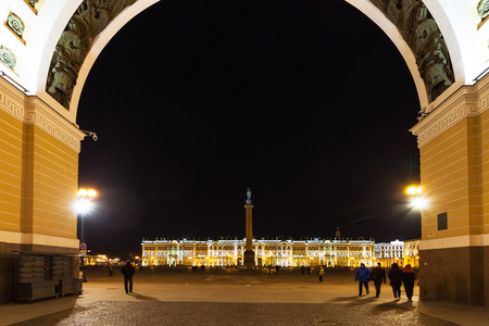 view of Palace Square with Alexander Column and Winter Palace through Triumphal Arch in Saint Petersburg city in night Editorial