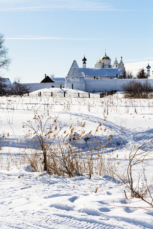 Convent of the Intercession (Pokrovskiy Monastery) on riverbank of frozen river in Suzdal town in winter in Vladimir oblast of Russia