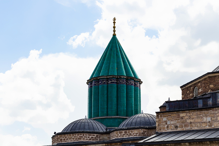 Travel to Turkey - green dome and roof of Shrine of Jalal ad-Din Muhammad Rumi (Mevlana) and Dervish Lodge (Tekke) of the muslim Mevlevi order in Konya city