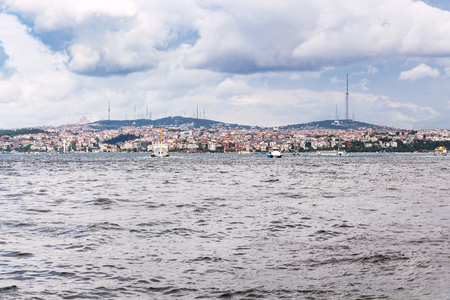 Travel to Turkey - view of Istanbul city on beach of Golden Horn bay in spring