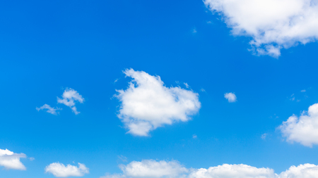 fluffy clouds in dark blue sky in sunny summer day in Kuban region of Russia Stock Photo