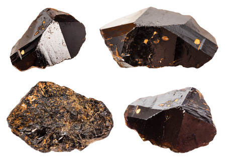 set of various Cassiterite (Tin ore) minerals isolated on white background Imagens