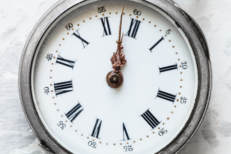 vintage pocket watch on white concrete background close up Archivio Fotografico