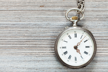 retro pocket watch on gray wooden background
