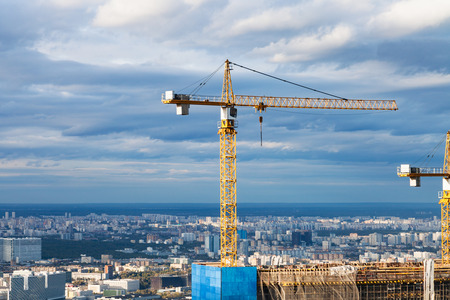 crane at construction site of skyscraper in Moscow city in autumn day