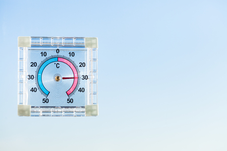 view of outdoor thermometer on home window and blue sky in hot morning Reklamní fotografie