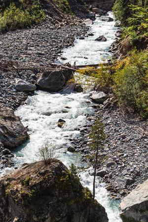 travel to North Caucasus region region - mountain river in Dombay resort village in Teberda Nature Reserve in Karachay-Cherkessia region of Russia in september