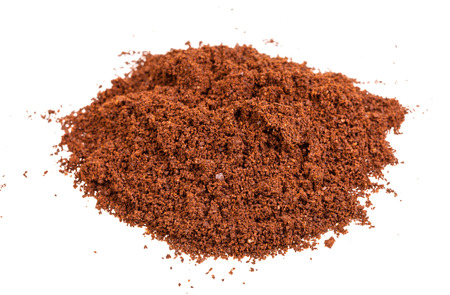 pile of freshly ground coffee isolated on white background