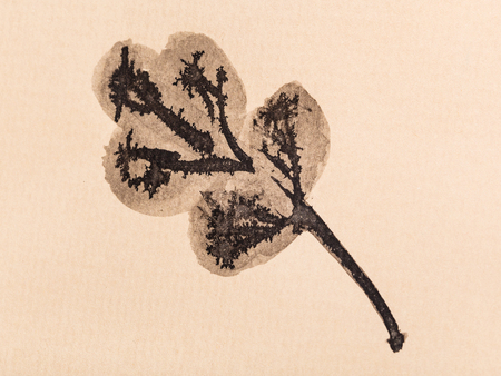 training drawing in sumi-e (suibokuga) style - oak leaf handpainted by black watercolors on yellow paper