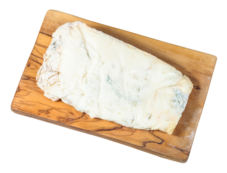 top view of piece of local italian Gorgonzola soft blue cheese on olive wood cutting board isolated on white background 스톡 콘텐츠
