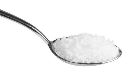 tablespoon with coarse grained Sea Salt close up isolated on white background