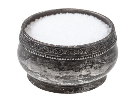 vintage silver salt cellar with fine ground Sea Salt isolated on white background