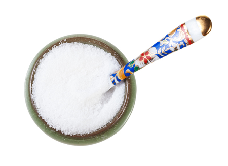 ceramic salt cellar with spoon with fine ground Sea Salt isolated on white background