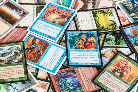 MOSCOW, RUSSIA - APRIL 2, 2019: surface from cards of Magic: The Gathering board game. Magic was the first trading card game, it was released in 1993 by Wizards of the Coast