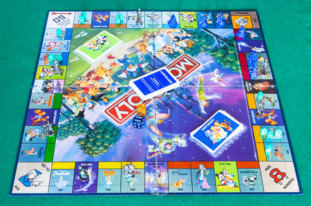 MOSCOW, RUSSIA - APRIL 3, 2019: playfield of Monopoly game, Disney edition. Monopoly is a board game that is currently published by Hasbro in 1935, it was designed by Lizzie Magie and Charles Darrow Editorial