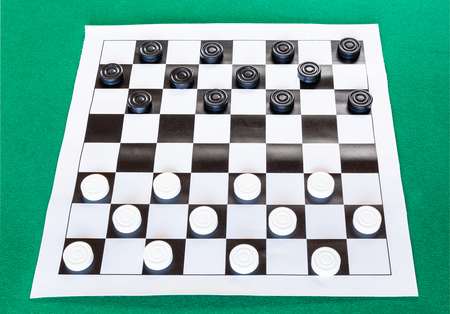 Checkers On Black And White Checkered Sheet Board On Green Baize