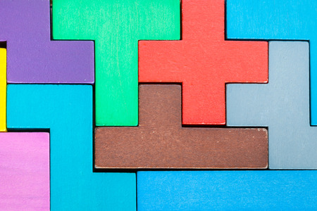 assembled puzzle from colored wooden pentominoes and blocks