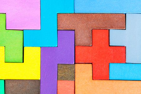 top view of assembled puzzle from colored wooden pentominoes and blocks