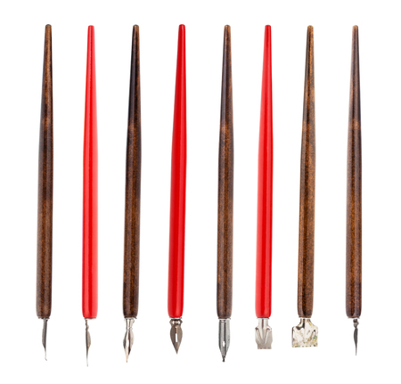 Collection from red and brown pen holders with various nibs isolated on white