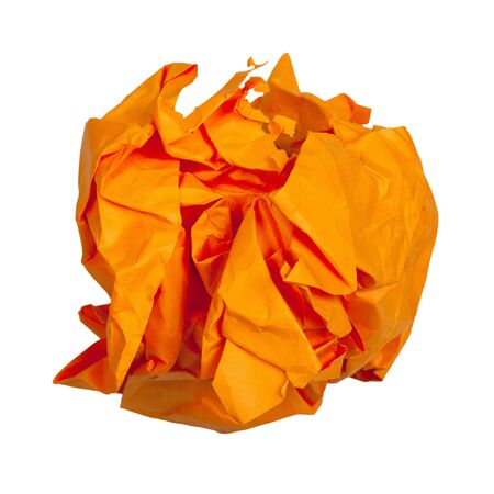 Crumpled ball from orange paper isolated on white