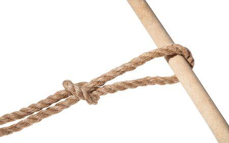 Nodo alla mano scivolato legato su una spessa corda di iuta isolata su bianco Archivio Fotografico